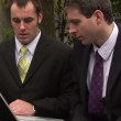 Stock Video: Two Men Businessmen Working as a team