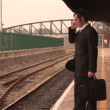 Man waiting for train - Stock Photo