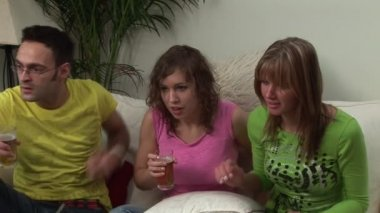 Group of Young Adults Watching Television — Stock Video