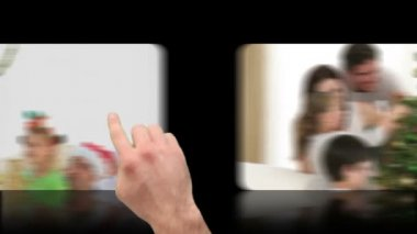 Hand activating christmas videos on touch screen — Stock Video #15366115