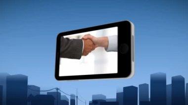 Smartphone showing a handshake — Stock Video