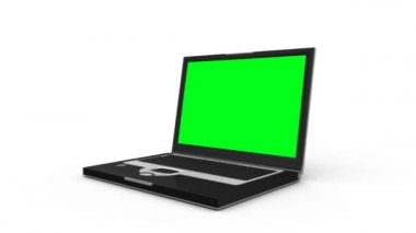 Laptop slides across the floor and opens to show a green screen before another laptop appears — ストックビデオ