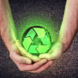 Stock Video: Hands holding recycling symbol