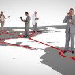 Businessmen on a map - Stock Photo