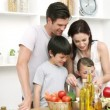 Young Family at home Preparing Food - Stock Photo