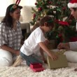 Happy family discovering the gifts on Christmas day — Stock Video