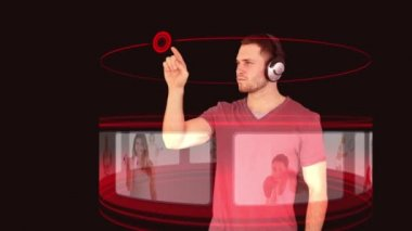 A man with headphones interacting with a 3d interface — Stock Video