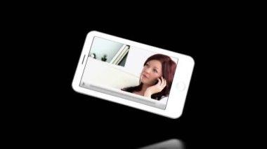 Smartphone showing businesswomen — Stock Video