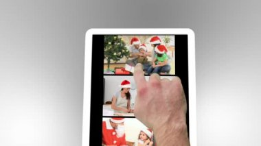 Tablet being used to watch two short christmas related family films with scrolling at the start — Stok video