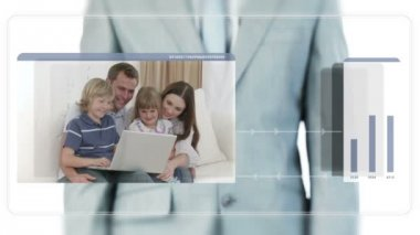 Businessman dragging videos about families using a laptop — Stock Video