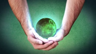 Hands holding a green globe — Stock Video