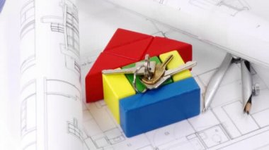 Close-up of plans, model house and keys turning — Stock Video
