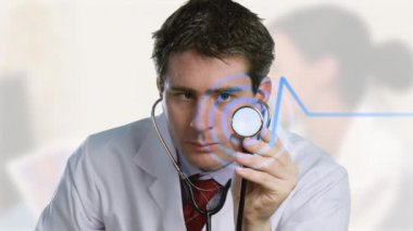 Doctor listening to a stethoscope — Stock Video