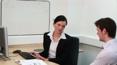 Businesswoman Conducting an Appraisal — Stock Video