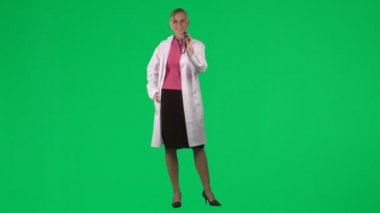 Footage of a female doctor using her stethoscope — Stock Video