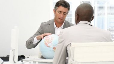 A meeting of businessmen around a terrestrial globe — 图库视频影像