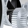 Interlocking gears in motion - Stock Photo