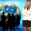 Businesswoman smiling at the camera with her team and the world in the background  — Stock Video