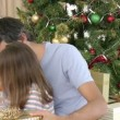 Close-up of father and daughter opening Christmas gifts — Stock Video