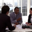 Stock Video: Confident business having brainstorming