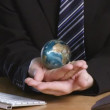 Businessman with a rotary terrestrial globe in his hand — Stock Video #15385443