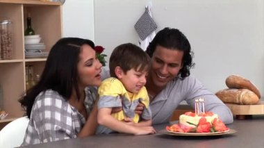 Adorable little boy celebrating his birthday with his parents — Stock Video