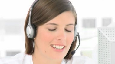 Businesswoman talking on a headset in the office — Stock Video