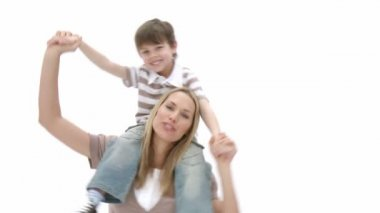 Woman giving little boy piggyback ride — Stock Video