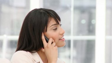 Charismatic young businesswoman on phone — Stock Video