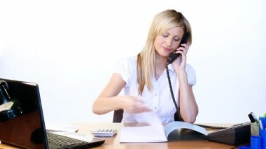 Businesswoman on phone and reading reports in office — Stock Video
