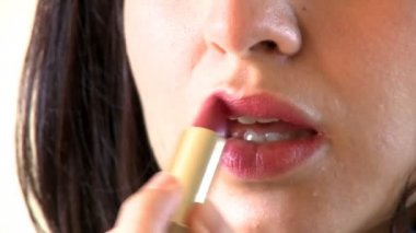 Close-up of a charming woman putting lipstick — Stock Video