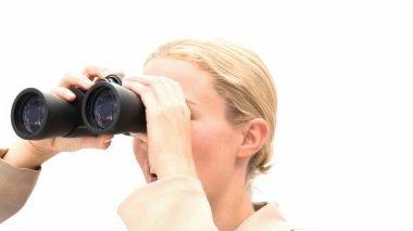 Blond business woman holding binoculars — Stock Video