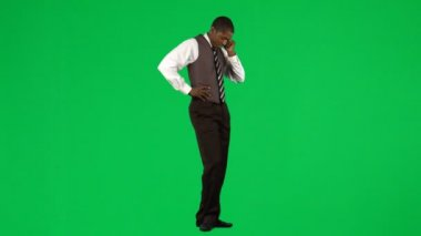 Afro-American businessman on phone against green screen — Stock Video