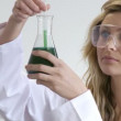 Royalty-Free Stock Vektorfiler: Woman looking at chemicals