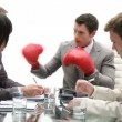Stressed manager wearing boxing gloves   — Vídeo de stock