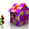 3D man achieving the building of his house - Stock Photo