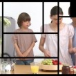 Stock Video: Animation of presenting 2 families in kitchen