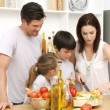 Family working in the kitchen - Stock Photo