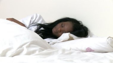 Ethnic woman waking up slowly — Stock Video
