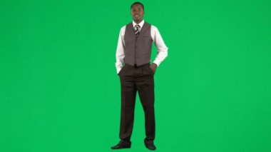 Afro-American businessman on mobile phone against green screen footage — Stock Video