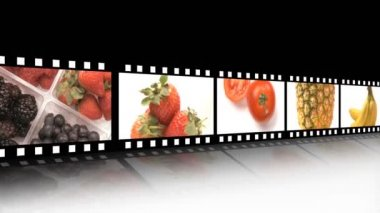 Assortment of Fruit and veg on a film reel — Stock Video