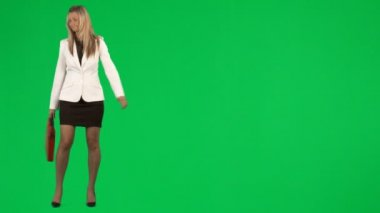 Businesswoman waiting for a transport against green screen footage — Stock Video