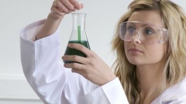 Blonde woman looking at chemicals