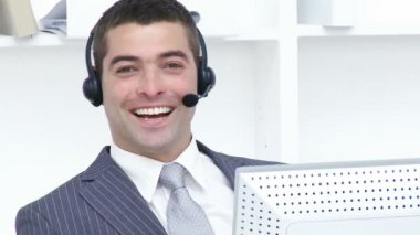 Attractive businessman working in a call center — Stock Video