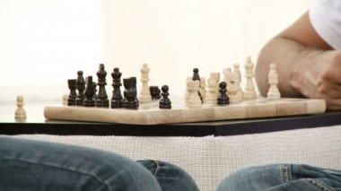 Close-up of two playing chess at home. Footage in high definition