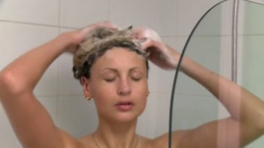 Sensual woman taking a shower — Stock Video