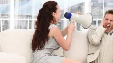 Young businesswoman talking through a megaphone — Stock Video
