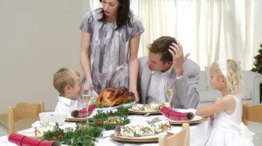 Happy family having Christmas dinner — Stock Video