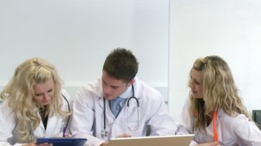 Three young doctors working together — Stock Video #15399643