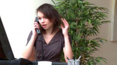 Pretty woman talking on phone — Stock Video